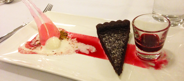 Baked chocolate tart, ivory chocolate sorbet, raspberry essence