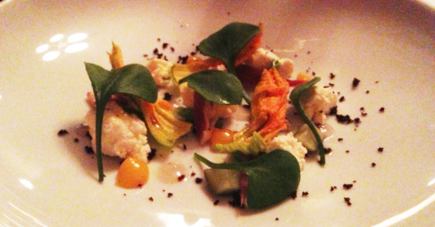Zucchini flowers with ricotta, egg yolk and olives