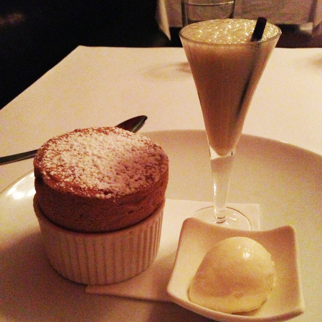 Chocolate ganache souffle with yoghurt ice-cream and pepper berry milkshake with a chocolate straw