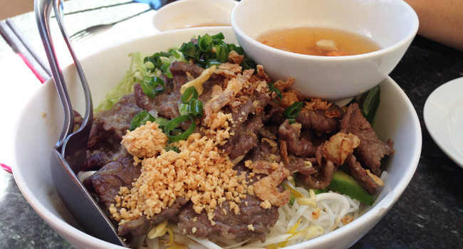 Stir fried marinated beef and salad with vermicelli, $14.90