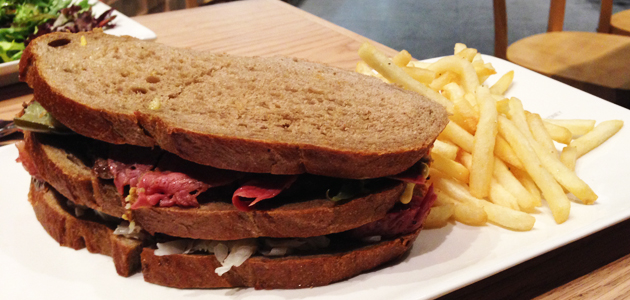 The new hot Reuben club sandwich with wagyu salt beef, rangers valley rump, spiced wagyu pastrami, stacked in rye bread with sauerkraut, pickles and mustard, $16.50