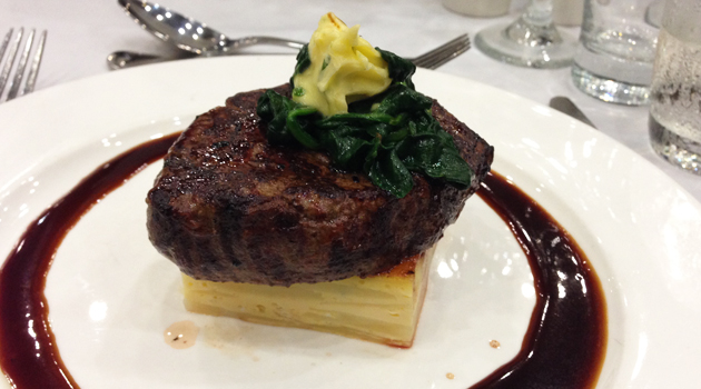 Grilled beef tenderloin with potato gratin, spinach, garlic butter and red wine jus