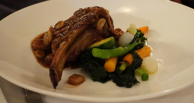 'Cote de Bouef a la Moelle' - Prime rib of beef with marrow sauce bordelaise, baby vegetables and wilted spinach, $40