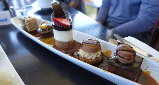 Sabor's Tasting Plate (Flourless Chocolate Cake with a Mini Macaron, Salted Caramel Mousse with Sticky Date Pudding, Dark & White salted burnt caramel Portuguese Mousse, Coffee  & Walnut Slice and a Jaffa chocolate mousse with chocolate ganache & Orange cube), $25