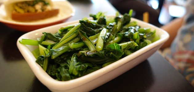 Steamed Asian greens with house sauce, $4.40