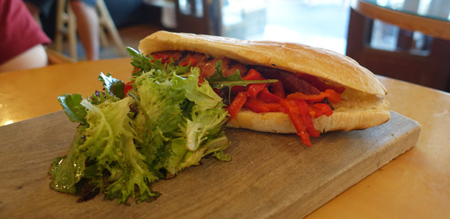 """The Town Dog"" (toasted panini with grilled chorizo & roasted peppers with kimchi), $15.50"