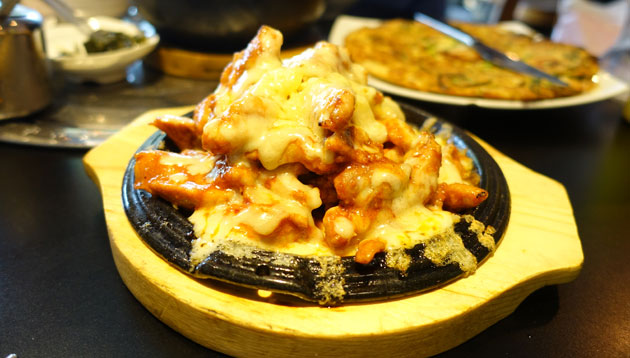 Fire Stir-fried Chicken with Cheese, $20