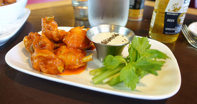 Buffalo Chicken Wings (hot and spicy, blue cheese fondue and celery sticks), $19