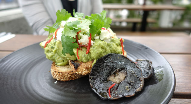 Smashed avocado with lemon, mint, coriander, goats feta, chilli on multigrain, with mushrooms on the side, $19.50