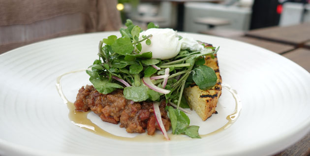 Grilled house-made cornbread with maple bacon jam, watercress salad and poached egg, $16.50