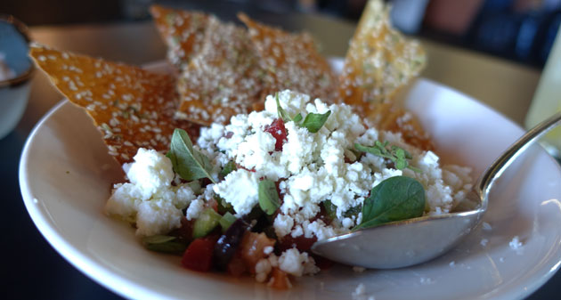 Greek salsa (Tomato, capsicum, cucumber, red onion, feta,  olives, sesame & fennel lavosh), $12.50