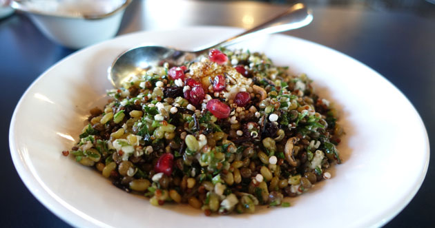 Grains salad (Barley, lentils, quinoa, pomegranate, cumin  yoghurt, cauliflower, puffed grains), $12.50