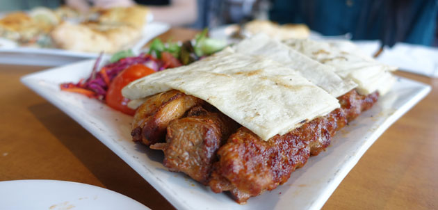 Mixed Grill (Combination of Adana, lamb, chicken kebabs served with salad and Turkish bread), $29