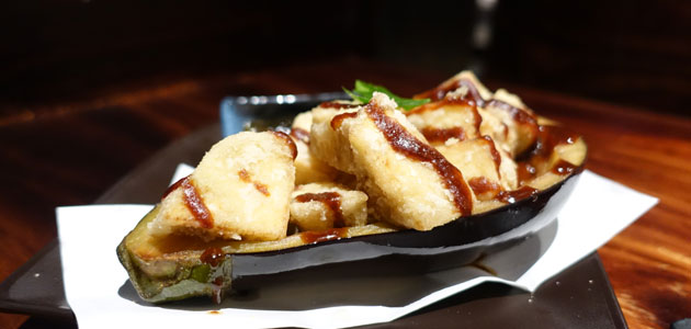 Grilled and fried eggplant cubes