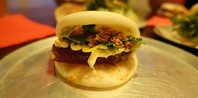 Slow Braised Pork Belly Bao with pickled mustard greens, crushed peanuts and kewpie mayo, $6.50