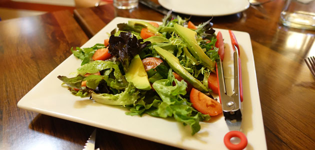 Mixed Green Avocado Salad (Mixed green salad, avocado, tomato, vinaigrette), $14