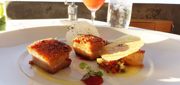 Crispy skin pork belly with pan seared sea scallops, lemon emulsion, chorizo, cuttlefish and piquillo pepper cous cous