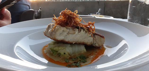 Crispy skin Cone Bay barramundi with spanner crab parcel, enoki mushroom, sage and eschalot cream