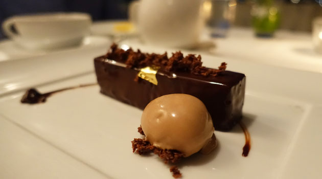 Caramel-centred dark chocolate mousse, feuilletine crumble, valrhona milk chocolate ice-cream