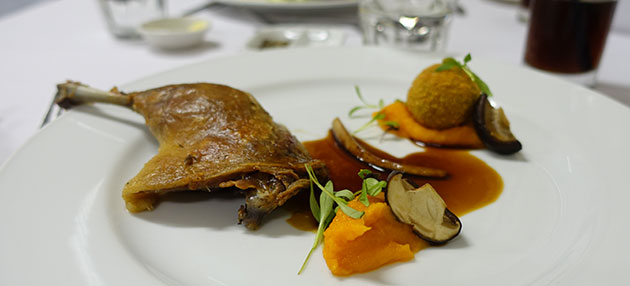 Confit Duck Leg with Carrot puree, Poached Shiitake and Mushroom Arancini