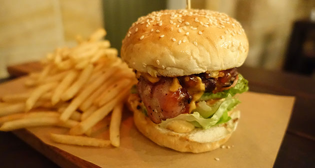 Greenwood Wagyu Burger with bacon, jack cheese, tomato relish, lettuce, tomato, chipotle aioli and fries, $17