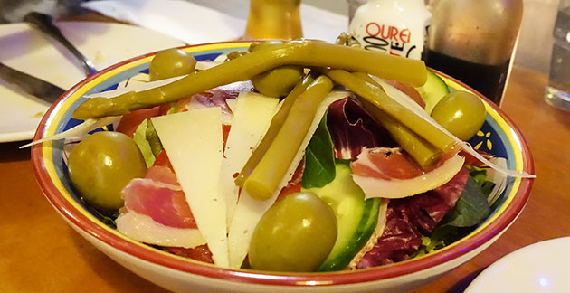 Ensalada Iberica (Lettuce, tomato, spanish onion, olive, cucumber, asparagus, serrano ham, manchego cheese seasoned with olive oil and red wine vinegar)
