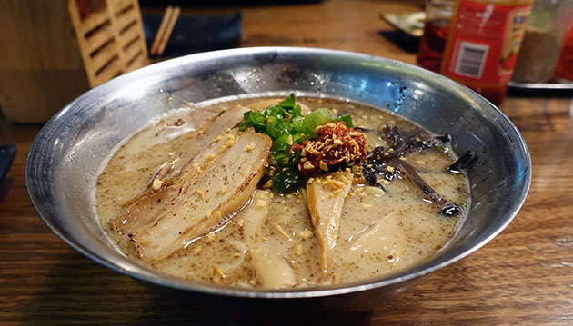 Hakata-Maru Tonkotsu (white tonkotsu with spicy miso, garlic oil, seasoned egg and slices of pork), $16.80
