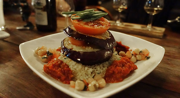 Vegan stack - roasted field mushroom, eggplant, toasted brussel sprouts, bush spiced cous cous, basil, chilli and bush tomato sauce, $18