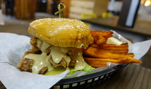 Mother Clucker burger with sweet potato fries, $12 + $2