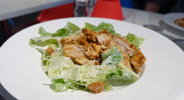 Small Caesar salad with chicken, $12.50EU