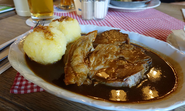 Traditional Bavarian roast pork with white cabbage salad and potato dumpling, 12.90 Euro