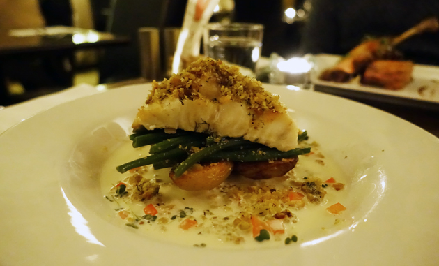 Baked Fillet of Irish Hake topped with homemade herb crumb, served with sauteed potatoes, green beans & lemon cream sauce