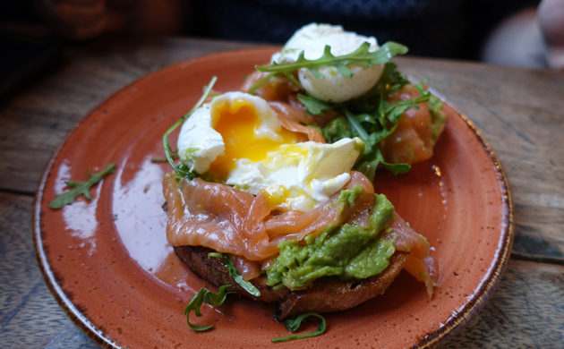 Smashed avocado on sourdough toast with poached eggs and smoked salmon and rocket, 10 GBP