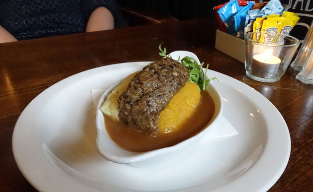 Wee Taste of Haggis, served with creamy mashed potatoes, bashed neeps and creamy whiskey sauce, 4.99 GBP
