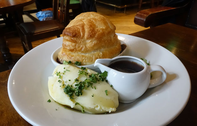 Steak and Ale Pie served with garden peas, creamy mashed potatoes and a jug of ale gravy, 9.99 GBP
