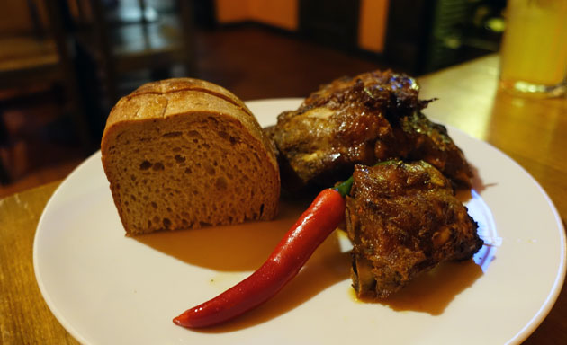 Honey marinated roast pork ribs with grilled chilli peppers and garlic bread, 179 Czech Koruna