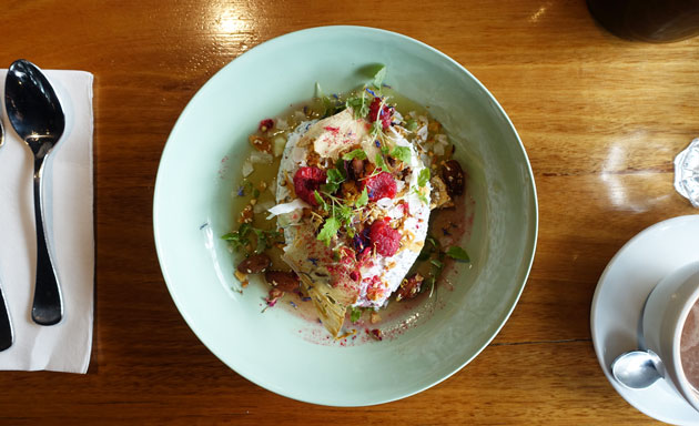 Coconut chia pudding with Queensland pineapple, raspberries, elderflower syrup and buckwheat crumble, $17 AUD