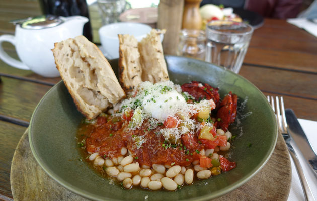 White beans with chipotle, heirloom tomatoes, smoked cheddar, poached egg, baguette and chorizo, $20
