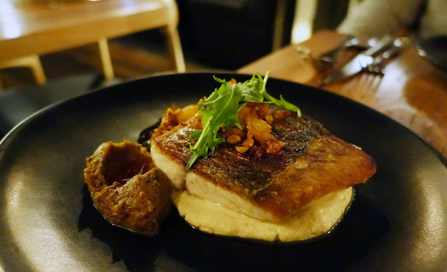 Roasted Barramundi with crispy falafel spiced chickpeas, chopped prawns and persimmon amba, $30 AUD