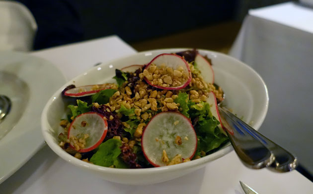 Soft leaves salad with radish, walnuts, Dijon vinaigrette