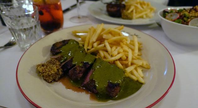 Steak Frites of grilled pasture fed Angus Porterhouse, frites, sauce Maison au beurre et aux herbes($44.90)