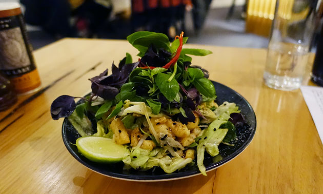 Crispy fried spiced calamari salad, toasted peanuts, roasted rice, fragrant herbs, lemon and lime dressing